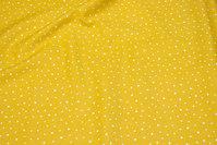 Messinggul bomuld med 1-2 mm hvide prikker