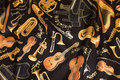 Music instruments on patchwork-cotton.