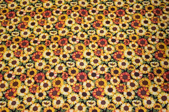 Patchwork-bomuld med små solsikkehoveder i gyldne farver