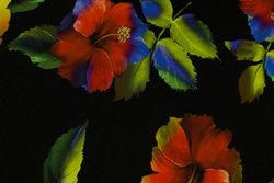 Sort bomuldsjersey med store flotte blomster i rød og gul