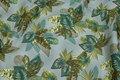 Støvgrøn bomuldspoplin med grønne blade.