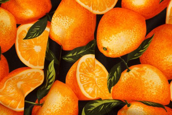 Store appelsiner på patchworkbomuld