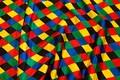 Harlekinmønstret satin i flotte farver til udklædning, dekoration m.m. der er også lilla tern på stoffet, det fremgår ikke af billedet.