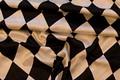 Harlekinmønstret satin til udklædning, dekoration m.m.  Ternene er 12 cm høje.  Kvaliteten er polyester