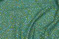 Økologisk patchwork-bomuld med konfettimønster.