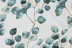 Deko-stof i hvid med søgrønne blade