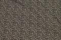 Cremefarvet patchwork bomuld med lille sort bladmønster.