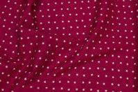 Kirsebærrød bomuld med 1 cm hvide stjerner