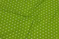 Limegrøn bomuld med hvide 1 cm stjerner.