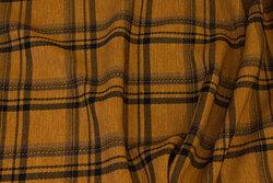 Modetern i gulbrun med sort tern