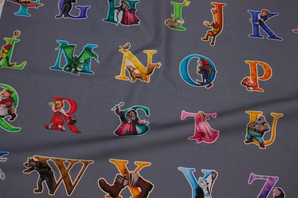Mørk grå bomuld med bogstaver og eventyrfigurer