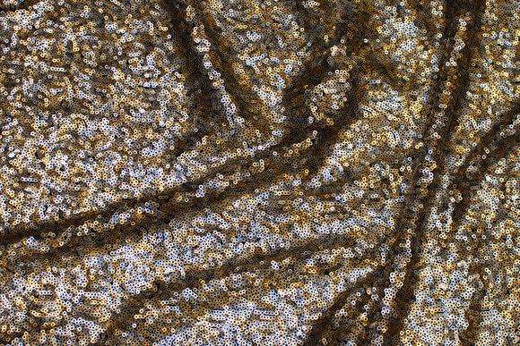 Paillet-stof med tætsiddende pailletter i sølv og guld