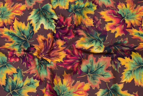 Brun, grøn og gullig patchwork-bomuld med efterårsløv