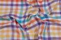 Orange-gul-lilla-turkis ternet bomuld i friske farver.
