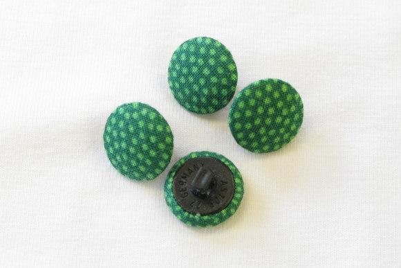Prikkede knapper græsgrøn