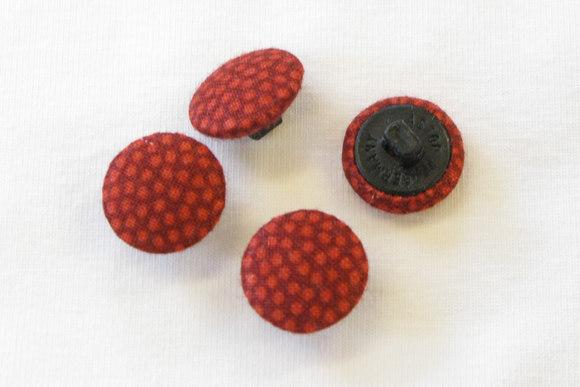 Prikkede knapper i rød-orange