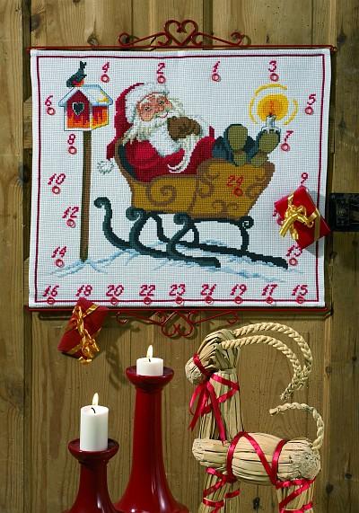 Hvid julekalender med Julemanden i kane