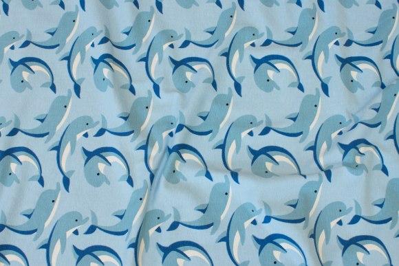 Lys blå bomuldsjersey med springende delfiner