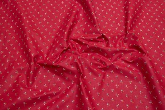 Rød bomuld med små pink blomster