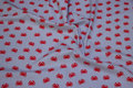 Light grey, woven cotton with 25 mm red crabs.