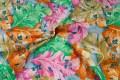 Orange-pink-grøn-blå store blomster på bomuld.