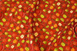Tomatrød bomuldsjersey med ca. 2 cm store frugter