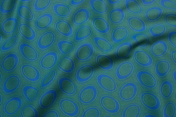 Grøn patchwork-bomuld med blå cirkler
