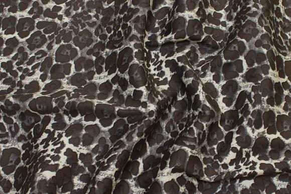 Bukse-stretch med dyreprint i jordfarvet og off-white
