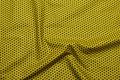 Karrygul patchwork-bomuld med 5 mm mørke stjerner.