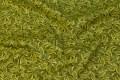Patchwork-bomuld i grøn og guld med bladmønster.