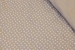 Quiltet dobbeltvævet bomuld (gauze) sandfarvet med hvide stjerner