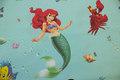Havfruen Ariel på turkis bomuld.