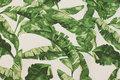 Knækket hvid deko-stof med store grønne blade.