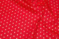 Kraftig rød deko- bomuld med 1 cm guldstjerner.