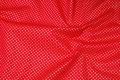 Kraftig rød deko-bomuld med lille guldprik.
