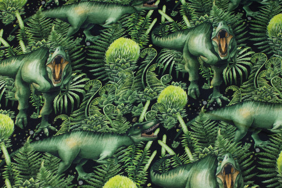 Bomuldsjogging med dinosaurer i grønne farver