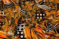 Flot bomuldsjersey i sort, orange, gyldne nuancer
