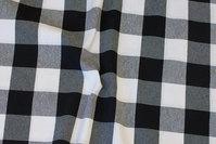 Mellemsvær bom og polyester i sort og hvid skaktern