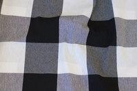 Mellemsvær bom og polyester med store skaktern i sort og hvid
