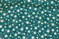 Dark green christmas-cotton with ca. 1-2 cm gold stars.