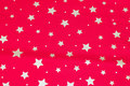 Red christmas-cotton with ca. 1-2 cm gold stars.