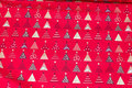 Red christmas-cotton with ca. 2 cm christmas trees.