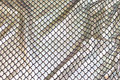 Sølv-holografi tryk på sort jersey.