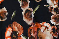 Sort bomuldsjersey med store rustfarvede blomster