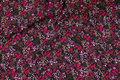 Sort viscose mousselin med små vinrøde blomster.