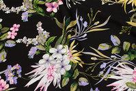Sort viscose mousselin med store, flotte hvide, røde og blå blomster