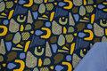 Softshell i marine og gul med lys blå fleecebagside.