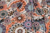 Viscose jersey i støvede lilla og orange nuancer