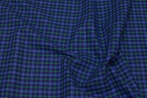 Krympebehandlet blågrønternet skjortestof