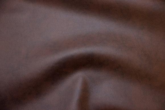 Brunmeleret imiteret læder